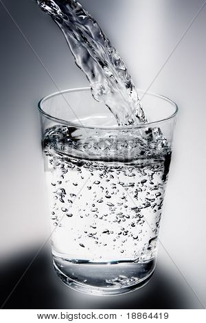 Water poured into glass with clipping path
