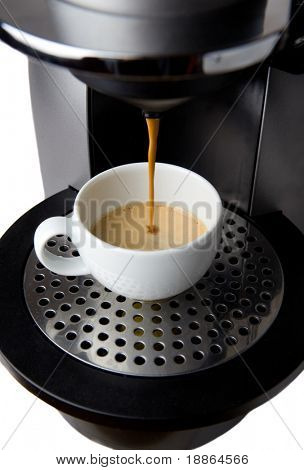 Coffee maker filling espresso in a cup on white