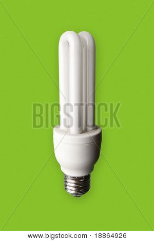 Energy saver light bulb turned off isolated on green background with clipping path