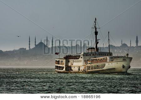 Passenger boat and The Blue Mosque Silhouette in Istanbul