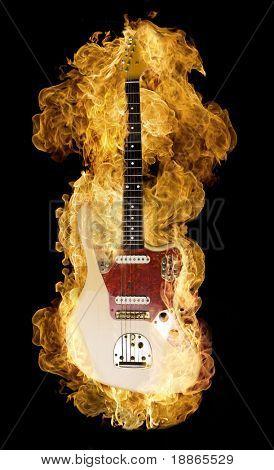 Classic electric guitar burning on black
