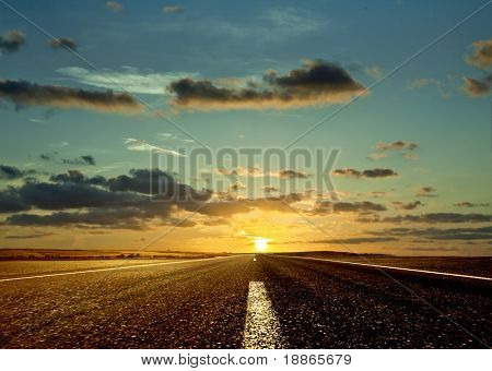 Road ahead and the sunrise