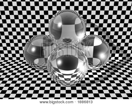 Three Glass Balls On Checkerboard Background