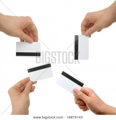 set of hands with magnetic cards