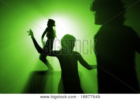 silhouettes of people on discothque