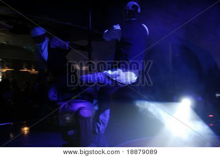 two men doncing on dancefloor