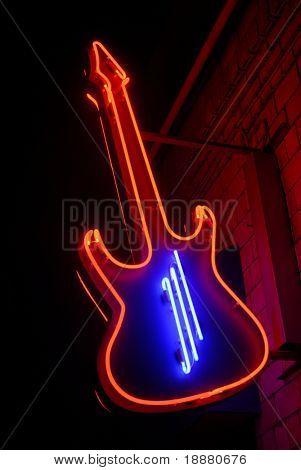 red neon guitar with blue strings