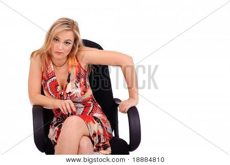 blonde wicked woman sitting in the armchair isolated on white