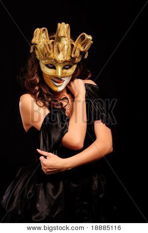 depraved woman in golden half mask isolated on black