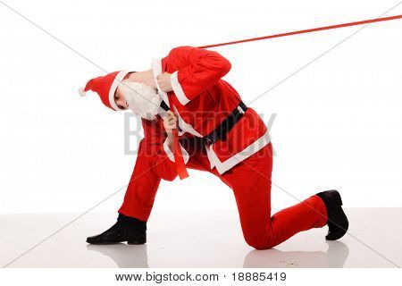 Santa Claus pull red ribbon, isolated on white