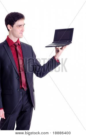 businessman hold black netbook on his fingers, isolated on white