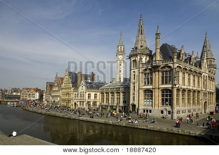 Quay of the medieval city Gent in Belgium Europe with view over old town and churches - students favorite place