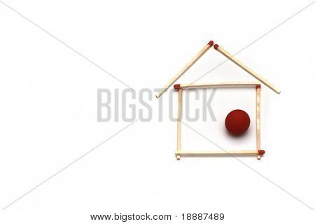 abstract house made of long match sticks isolated on white