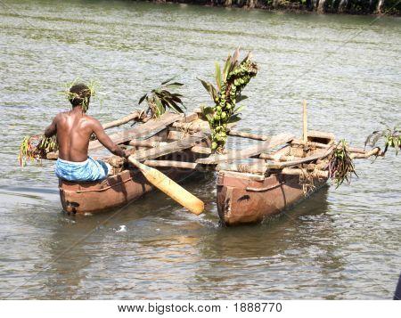 Melanesian In Wooden Outrigger Canoe