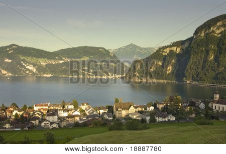 Swiss mountains and  town by the lake of Luzern in the sunset