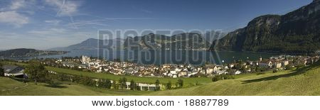 Large panorama of Swiss mountains and town by the lake of Luzern