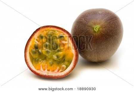 two fresh passionfruits on white background