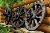 image of ox wagon  - Old wheels from a cart - JPG