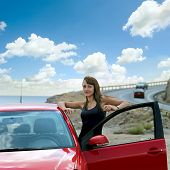 foto of girl next door  - beautiful girl next door with a red car - JPG