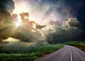 picture of hazy  - The road through the meadow and the stormy skies - JPG