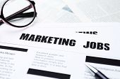 Paper sheet with text MARKETING JOBS, closeup poster