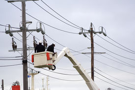 image of power lines  - Workers in cherry picker fixing power lines - JPG