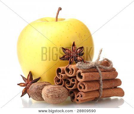 Cinnamon sticks, apple, nutmeg and anise isolated on white