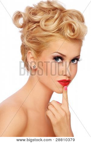Young beautiful sexy stylish blond girl with thoughtful expression, on white background