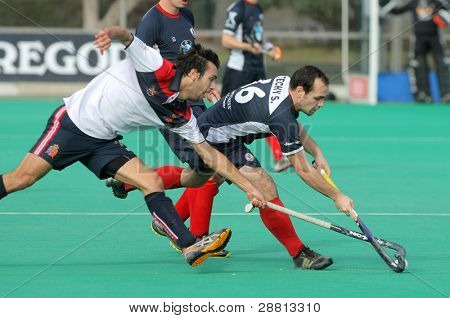 BARCELONA - JAN, 6: Gabriel Dabanch(L) of RC Polo vies with Sebastien Techy(R) of KHC Leuven during a King's Trophy match at the RC de Polo pitch on January 6, 2012 in Barcelona, Spain