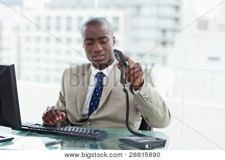 Entrepreneur hanging up in his office