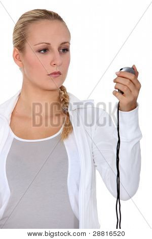 Young women with stop watch