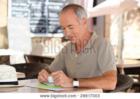 Man having a coffee on a terrace