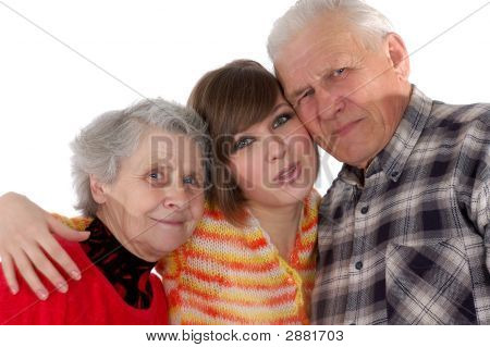 Happy Grandparents And Granddaughter Looking At Camera