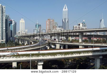 SHANGHAI, CHINA - NOVEMBER 27: Modern highways and multi-tiered fly-overs criss-cross the Shanghai skyline as this city emerges into a financial powerhouse on November 27, 2011 in Shanghai, China.