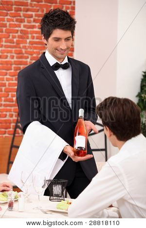Sommelier presenting a wine