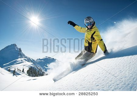 Young snowboarder in deep powder - extreme freeride