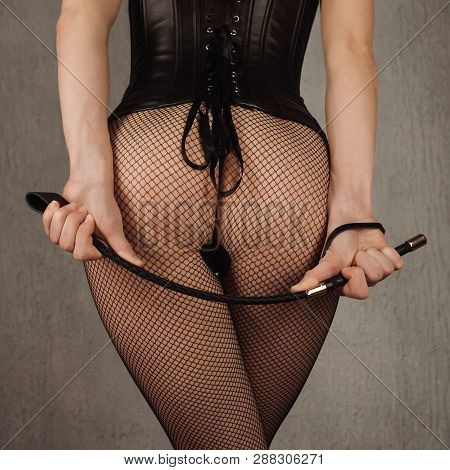Sexy Lady In Bdsm Outfit