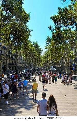 BARCELONA, SPAIN - AUGUST 16: La Rambla on August 16, 2011 in Barcelona, Spain. Thousands of people walk daily by this popular pedestrian mall 1.2 kilometer-long