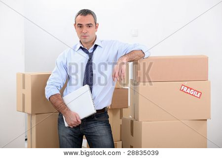 Man stood by stacked boxes