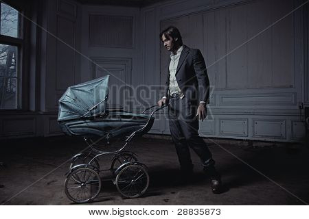 Fashionable man with a perambulator