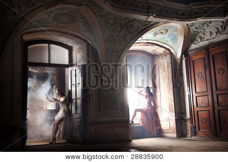 Two sexy woman in extremely big room