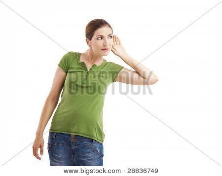 Woman listening something with hand on the ear, isolated on white