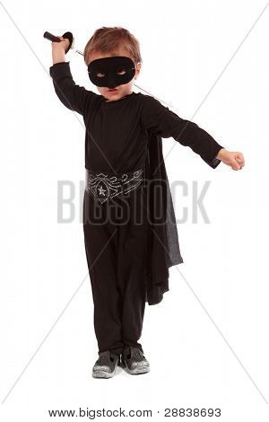 Young boy dressed in Zorro halloween costume