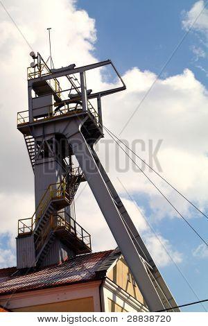 Coal mine headgear tower on blue sky
