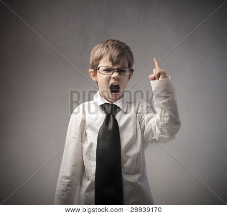 Angry child disguised as businessman