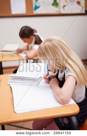Portrait of pupils working in a classroom