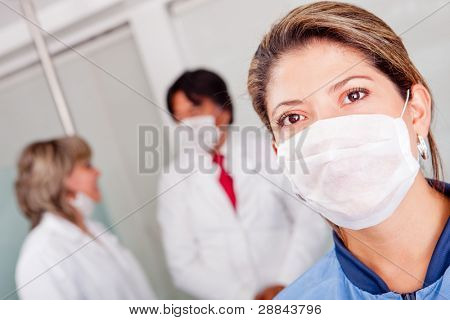 Female doctor at the hospital wearing a facemask