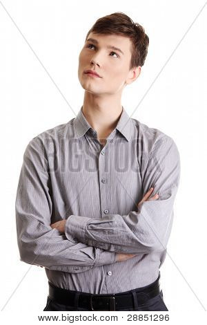 Closeup portrait of a casual young pensive businessman looking up