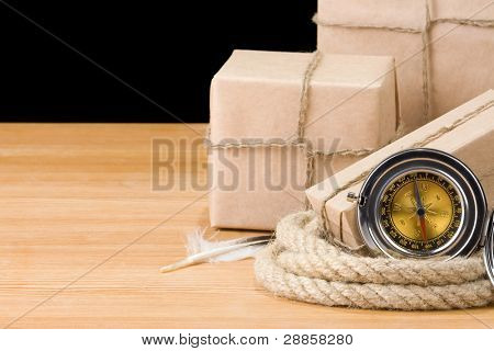 parcel wrapped box and rope on wood isolated over black background