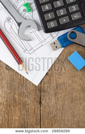office supplies on drafting over wood background